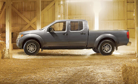 2021 Nissan Frontier side view while parked in a barn
