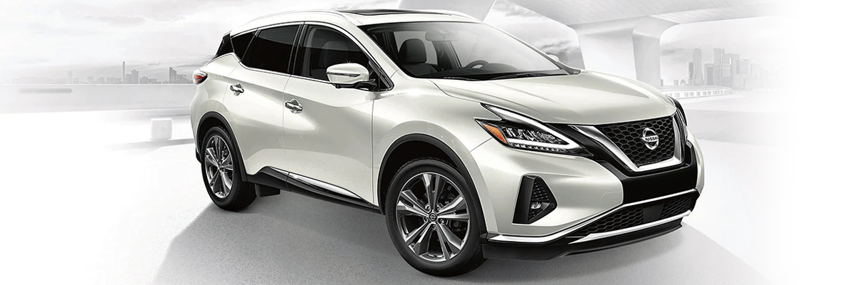 white 2021 Nissan Murano shown with city background