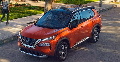 Orange Nissan Rogue SUV
