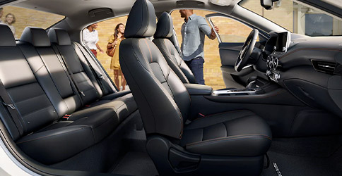 2021 Nissan Sentra seen premium interior from the passenger side with people about to get indriver's side front and rear