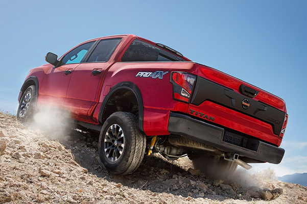 2021 Nissan Titan PRO-4X in red climbing a large rock pile