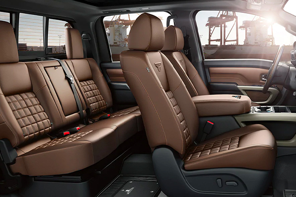 2021 Nissan TITAN crew cab interior with dock cranes behind it