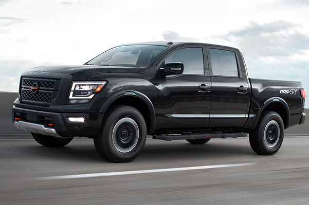 2021 Nissan TITAN PRO-4X in black showing Intelligent Around View coverage on a highway