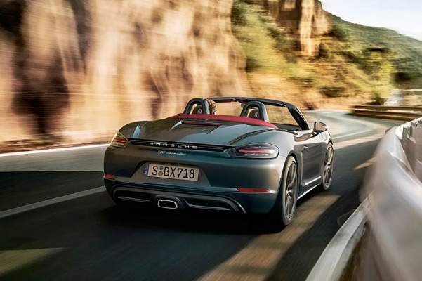 rear view of the 2021 Porsche 718 Boxster driving down a road