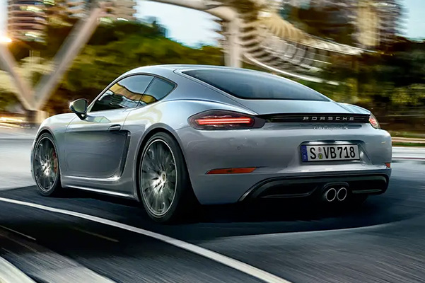 rear view of a 2021 Porsche 718 Cayman driving down the road