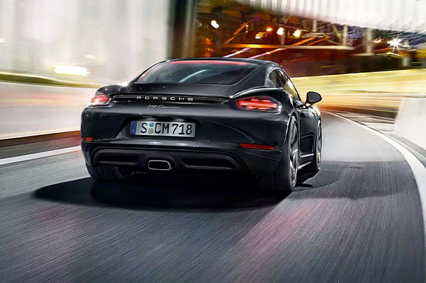 rear view of the 2021 Porsche 718 Cayman driving down the road