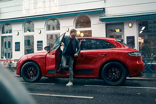Man getting out of 2021 Porsche Macan