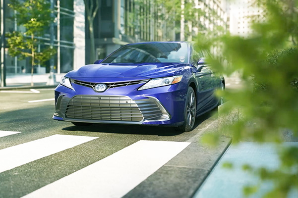 2021 Toyota Camry driving in a city