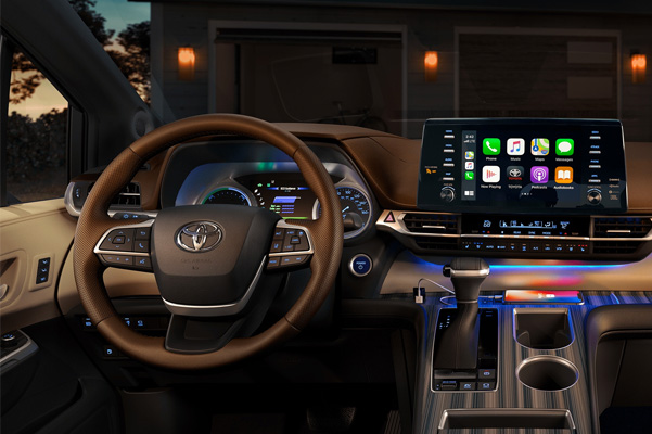 Platinum interior shown in Nobel Brown with Apple CarPlay® compatibility. Prototype vehicle shown with options using visual effects.