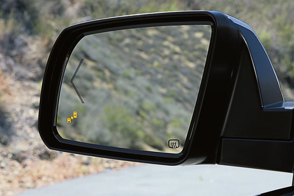 close up of Toyota Tundra's side mirror showcasing bling spot yellow icon activated