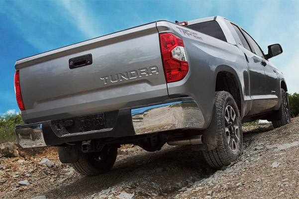 rear view of Toyota Tundra going up hill on a tough mountain terrain