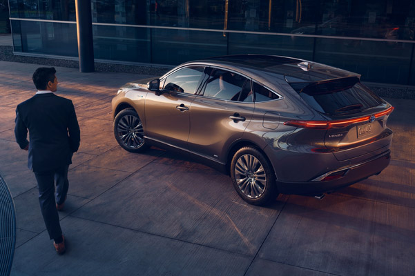 2021 Toyota Venza in grey parked as man walks by