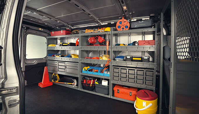 A shot of the cargo area of a 2022 Ford E Transit with shelving filled with equipment