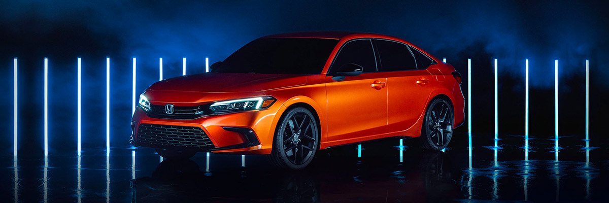 orange 2022 honda civic parked on a mysterious background