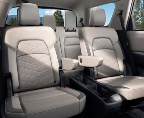 interior view of 2022 nissan pathfinder suv featuring captain chairs in white leather