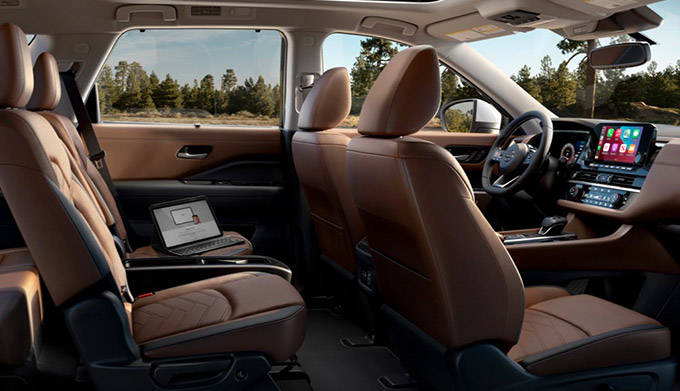 side profile interior view of 2022 nissan pathfinder showcasing leather seats and driver dashboard with digital screen