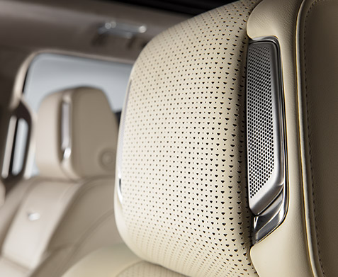 2022 Cadillac Escalade Sport Platinum; interior detail image seen in Whisper Beige with Gideon Accents showing the AKG headrest speaker