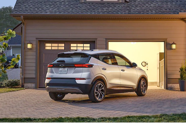 Rear view of 2022 Chevy Bolt EUV in front of open garage
