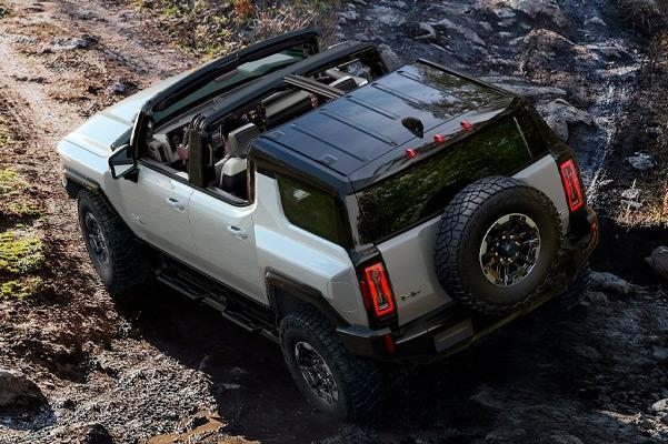 2022 HUMMER EV navigating through rocky mountains