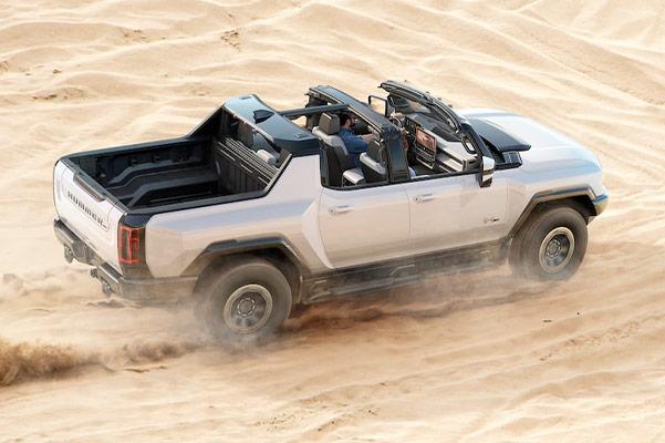 2022 HUMMER EV riding on sand
