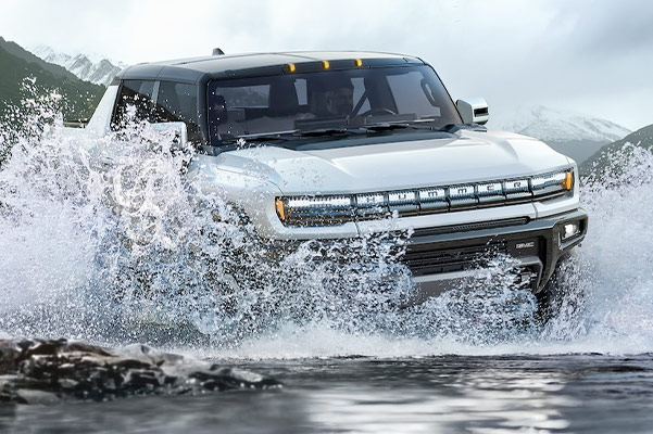 2022 HUMMER EV splashing through water