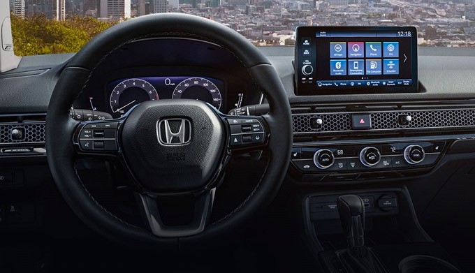 Interior view of the steering wheel and dash in the 2022 Honda Civic Touring Sedan with Black Leather.
