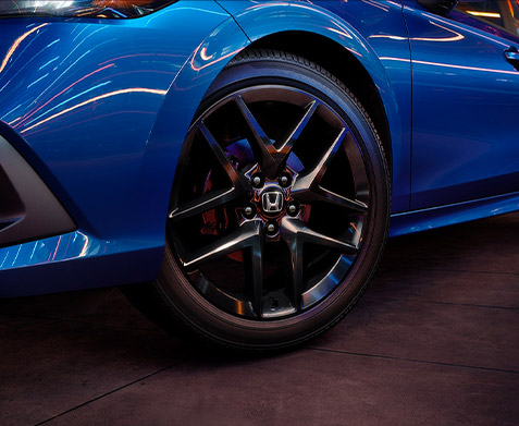 Sport shown in Aegean Blue Metallic - With trim-exclusive styling details like 18-inch gloss-black wheels, the Sport trim offers an added touch of attitude.