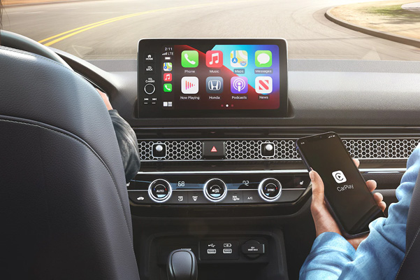Touring shown with Black Leather. Wireless Apple CarPlay® integration standard on Touring.