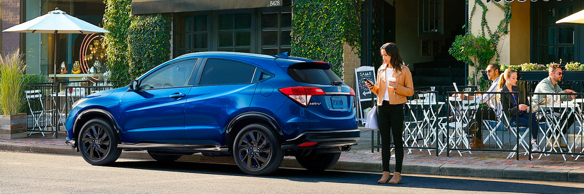 2022 honda hr-v parked in front of a coffee shop