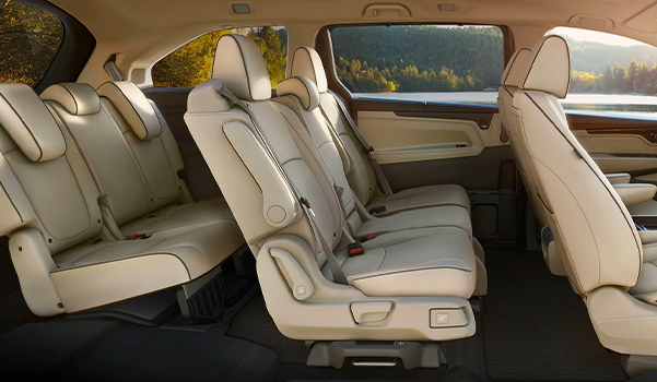 Interior passenger-side profile view of the 2022 Honda Odyssey Elite with Beige Leather.