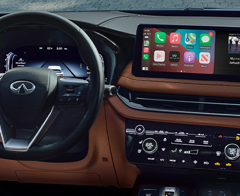Interior close up of 2022 INFINITI QX60 Apple CarPlay feature on 12.3 inch infotainment touchscreen