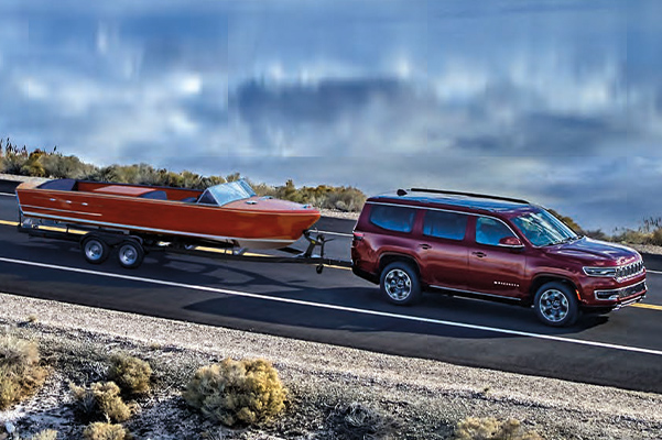 Wagoneer Series III in Velvet Red Pearl towing boat