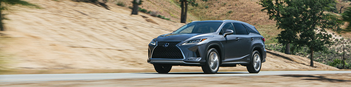 Front view of 2022 Lexus RX driving on the road