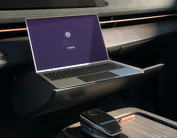 Nissan Ariya movable front console shown with laptop