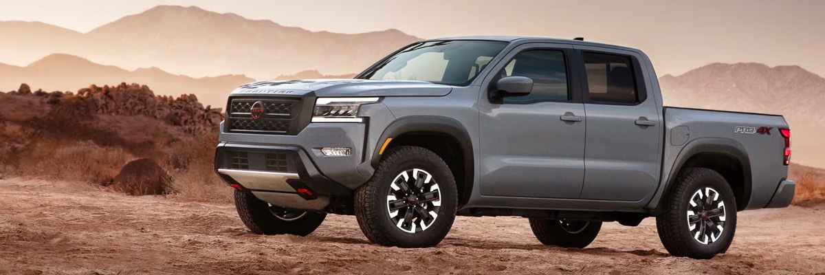 Side profile of the all new 2022 Nissan Frontier offroading