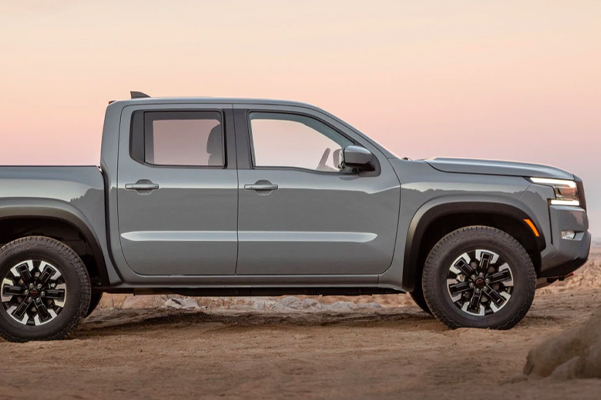side profile view of the 2022 nissan frontier parked