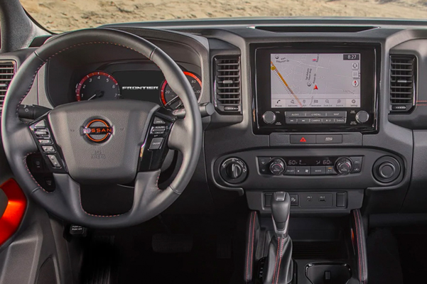 interior wheel and dash view of the 2022 nissan frontier