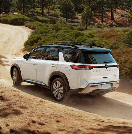 2022 Nissan Pathfinder rear view driving on dirt road