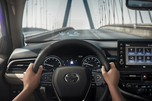 Driving the 2022 Toyota Camry with speed projected on the windshield