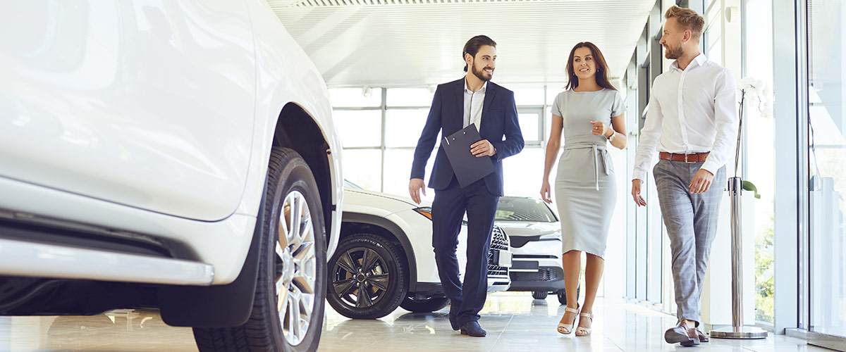 Customers walking through car dealership