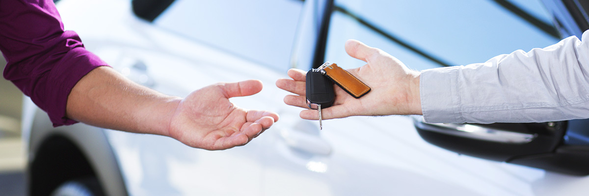 Handing car keys to customer