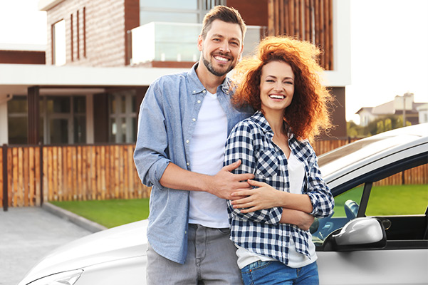 Couple Enjoying their new car that was delivered