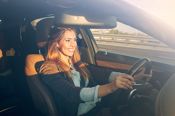 Woman enjoying new INFINITI she had delivered
