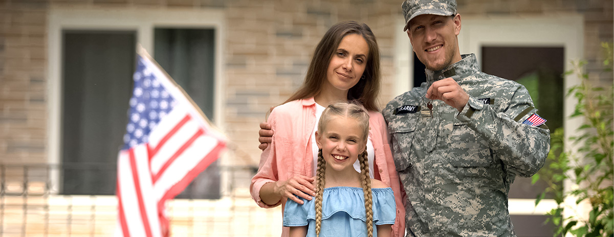 Military family outside home with new car purchase