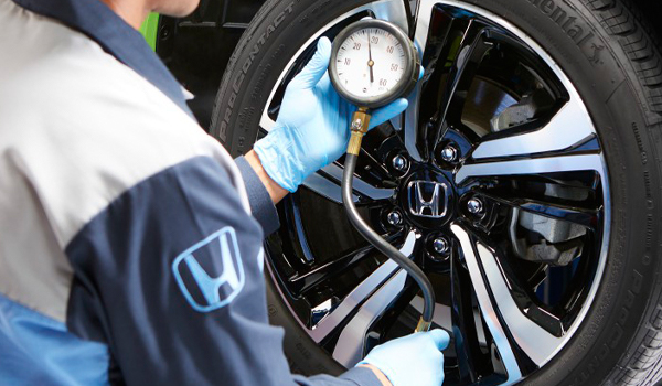 Honda tech checking vehicle
