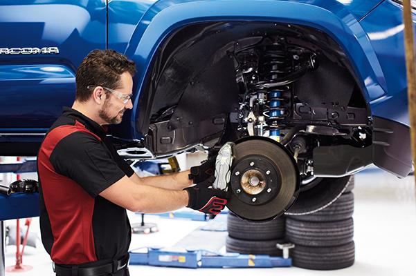Toyota tech checking vehicle