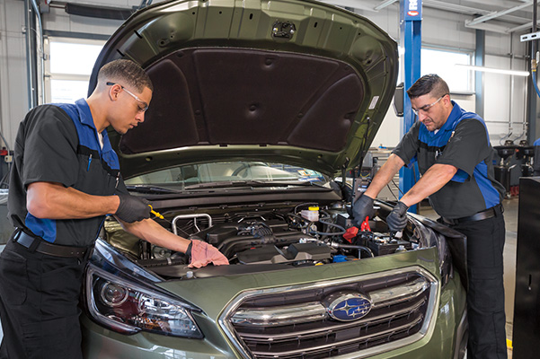 2 service employees working on a Subaru