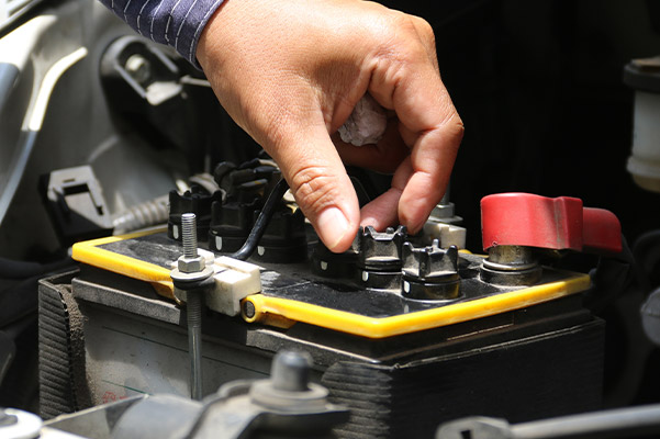 team member checking the battery on a new infiniti
