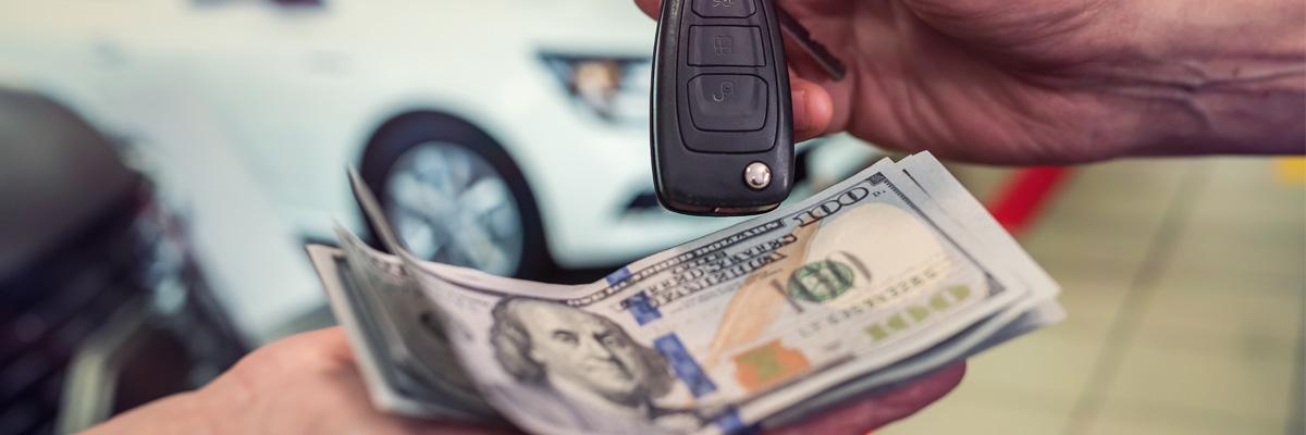 Car salesman giving car keys to customer