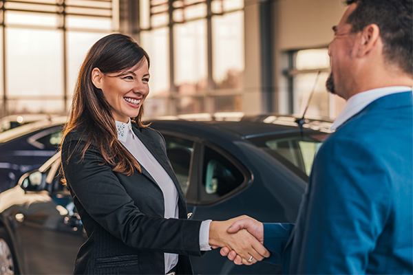 Women shaking hands with a man